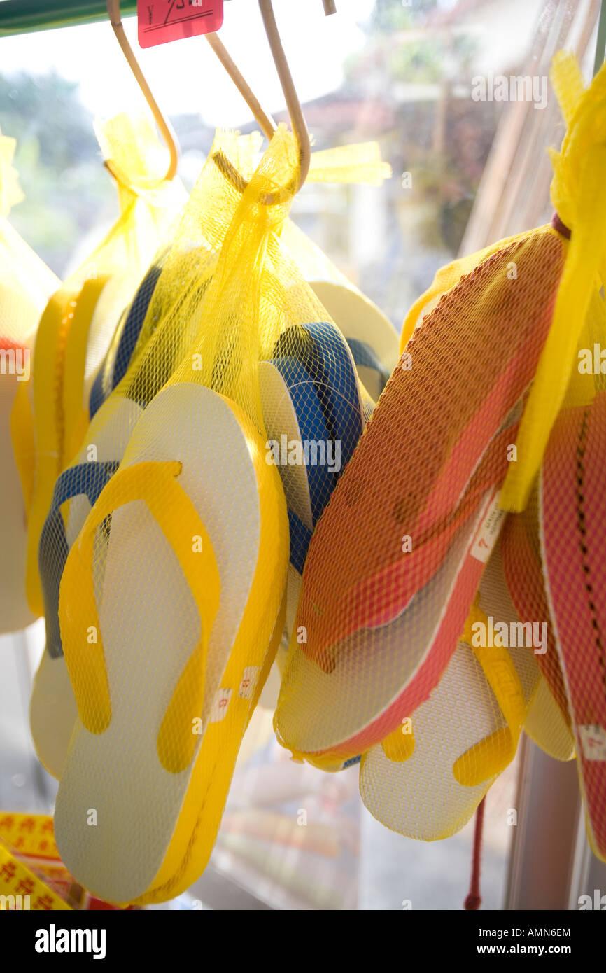 3eea610db60b Flip-flops hanging in shop Stock Photo  15302731 - Alamy
