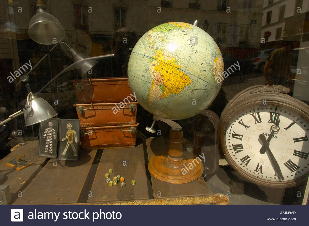 Paris France Montmatre. Antique shop window with old globe and clock. Bric a bac. - Stock Image