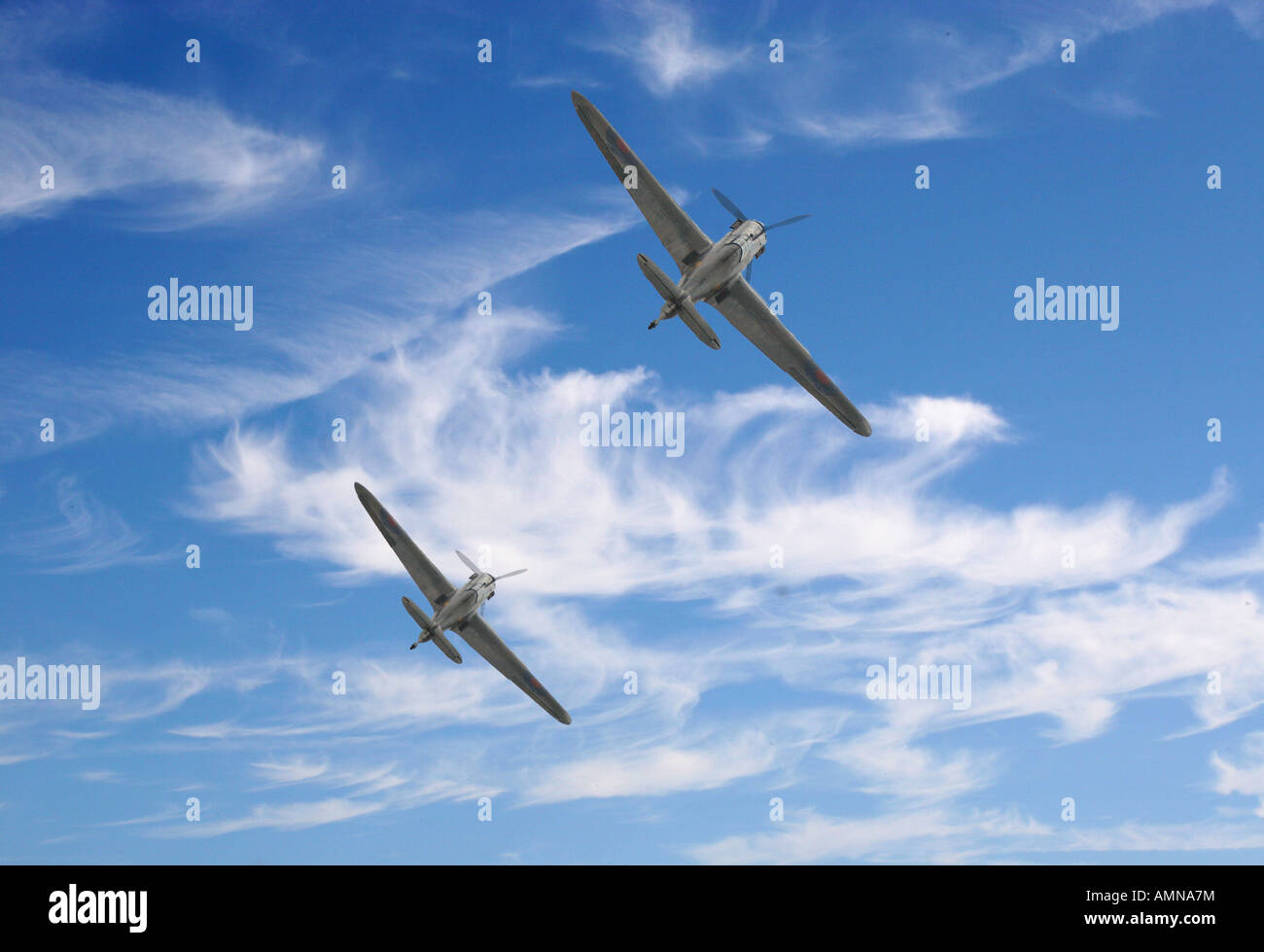 WW2 Hurricane fighter flying away from camera with clear blue summer sky. - Stock Image