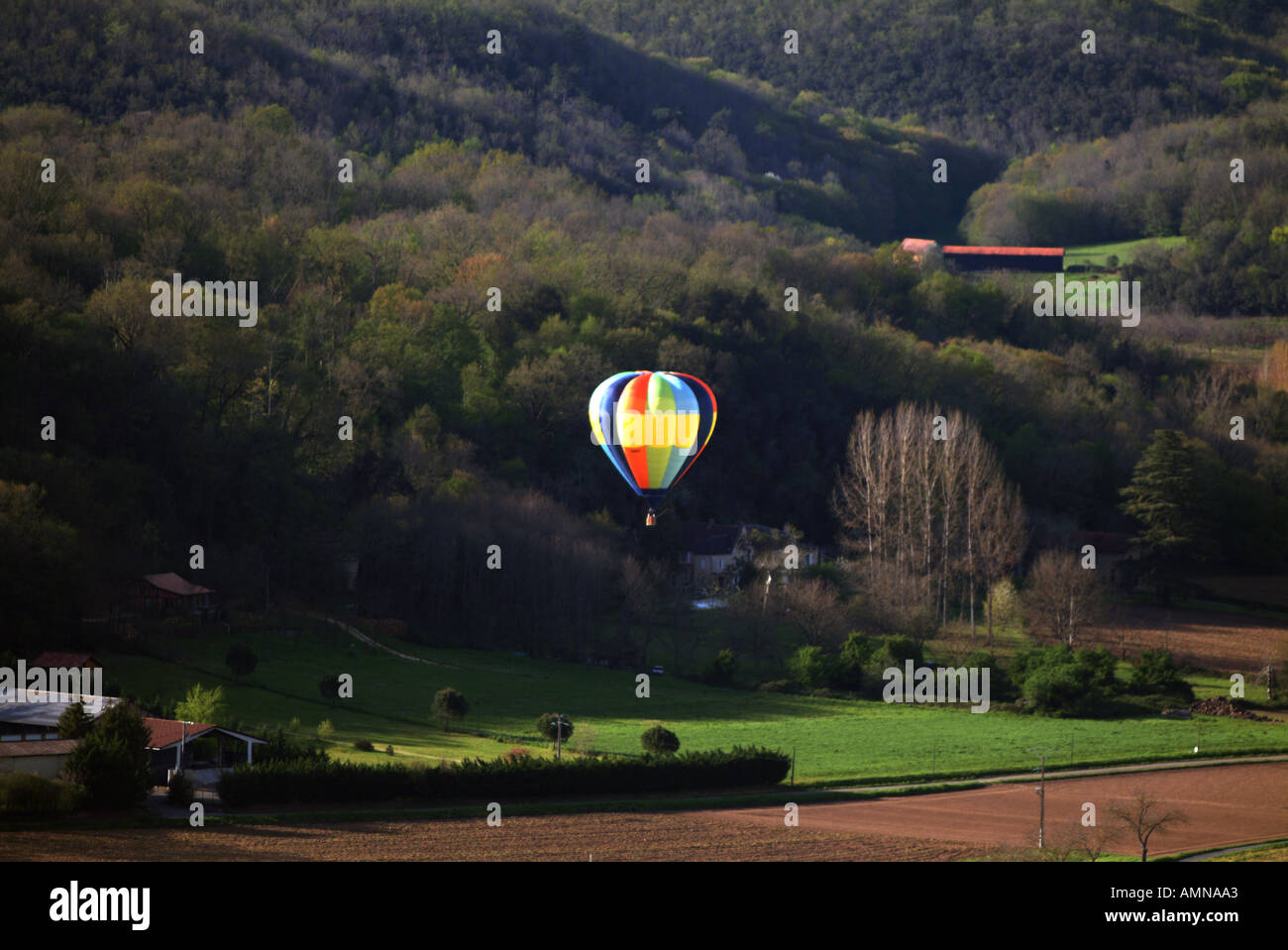 Hot air balloon above French countryside seen from Domme Stock Photo