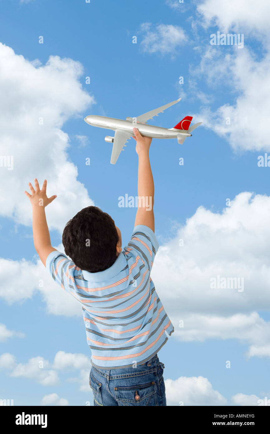 Boy Playing with Toy Airplane Stock Photo
