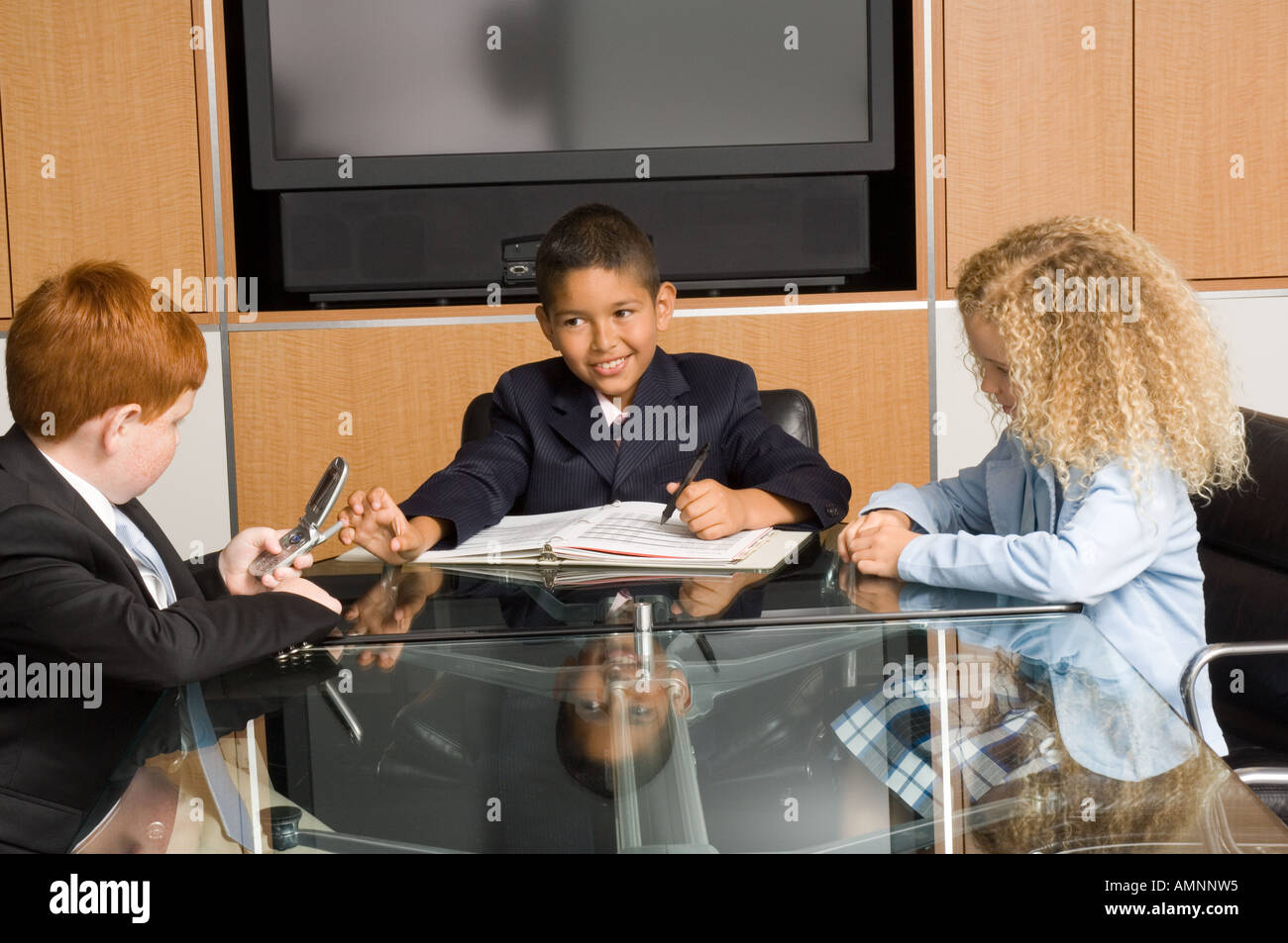 Young business children in office meeting - Stock Image