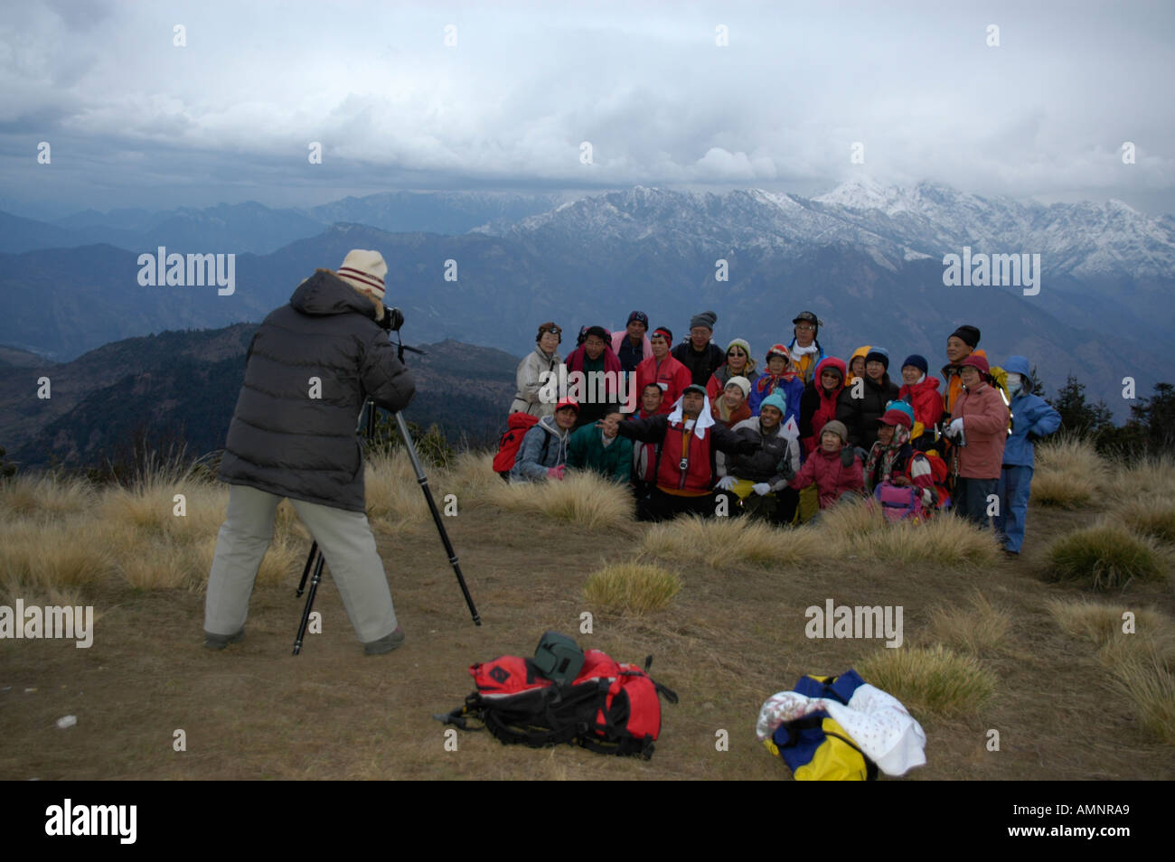 Group of Japanese tourists are beeing photographed on the summit of Poon Hill Annapurna Region Nepal - Stock Image