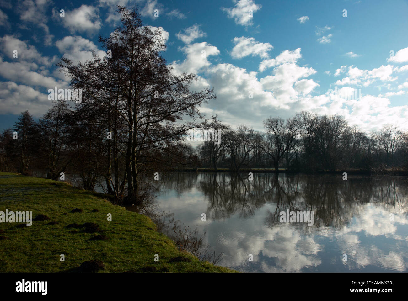 A beautiful scene of the River Thames at Medmenham, Buckinghamshire on a sunny December day. Stock Photo