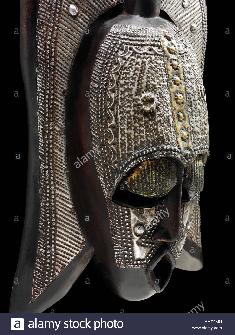 Ethnic traditional African mask used for tribal dances and events. Carved from wood. Art and craft. - Stock Image