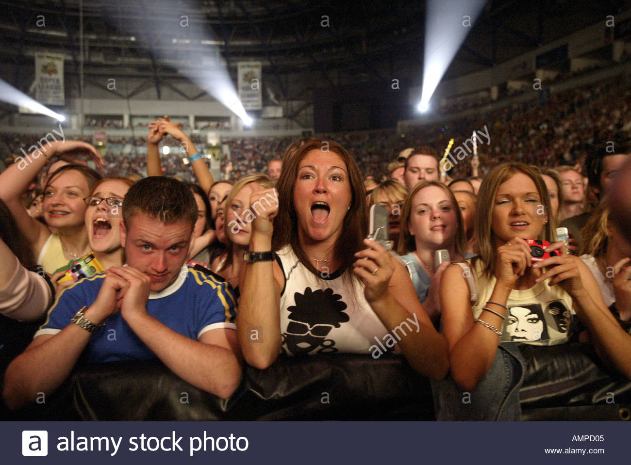 Fans at a concert in the Odyssey Arena - Stock Image