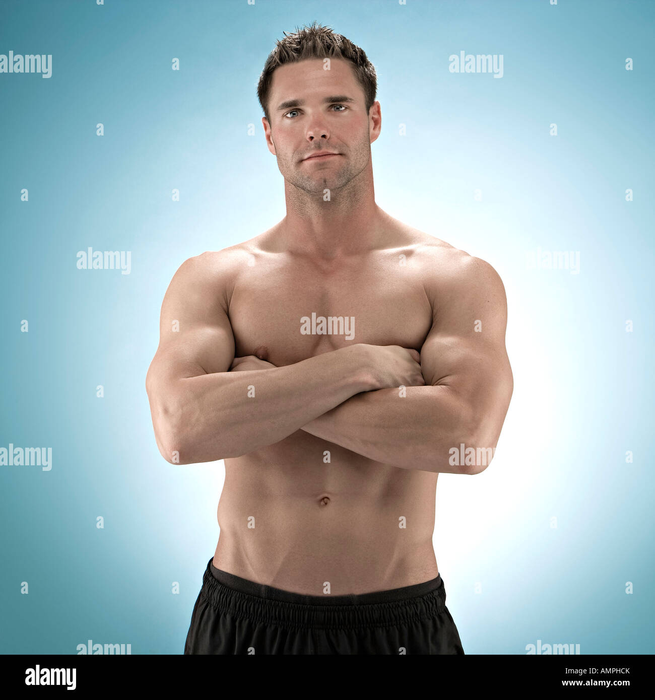 Beauty photo of muscular 20-30 year old man with shirt off. - Stock Image