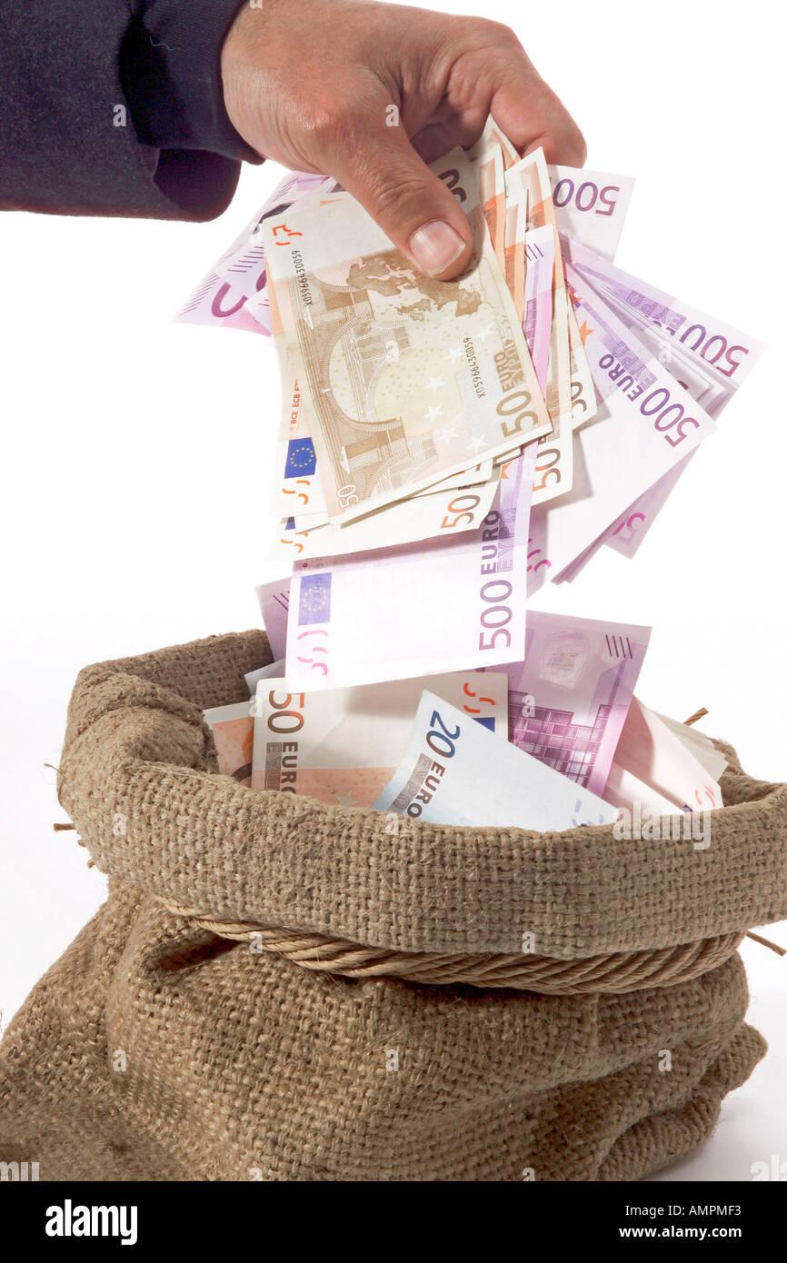 Man taking money from sack Stock Photo