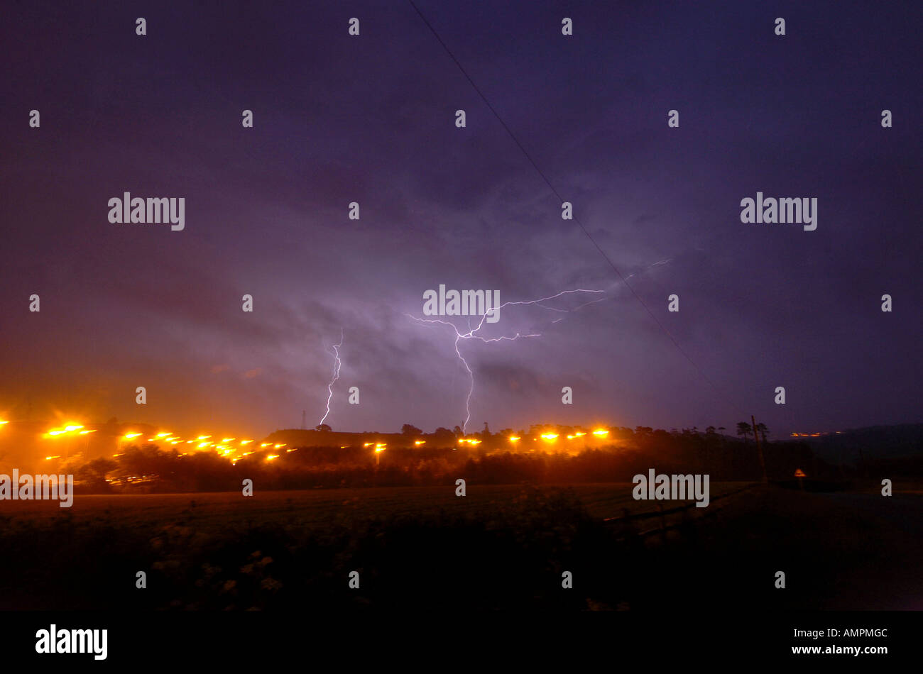 Lightning strikes over the Exe estuary in Devon 12th June 2006 - Stock Image