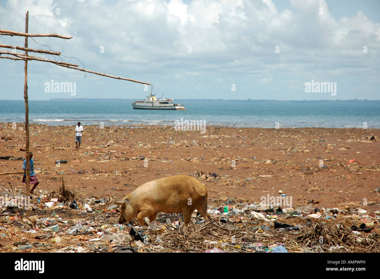 Reclaimed land from the sea using rubbish Stock Photo