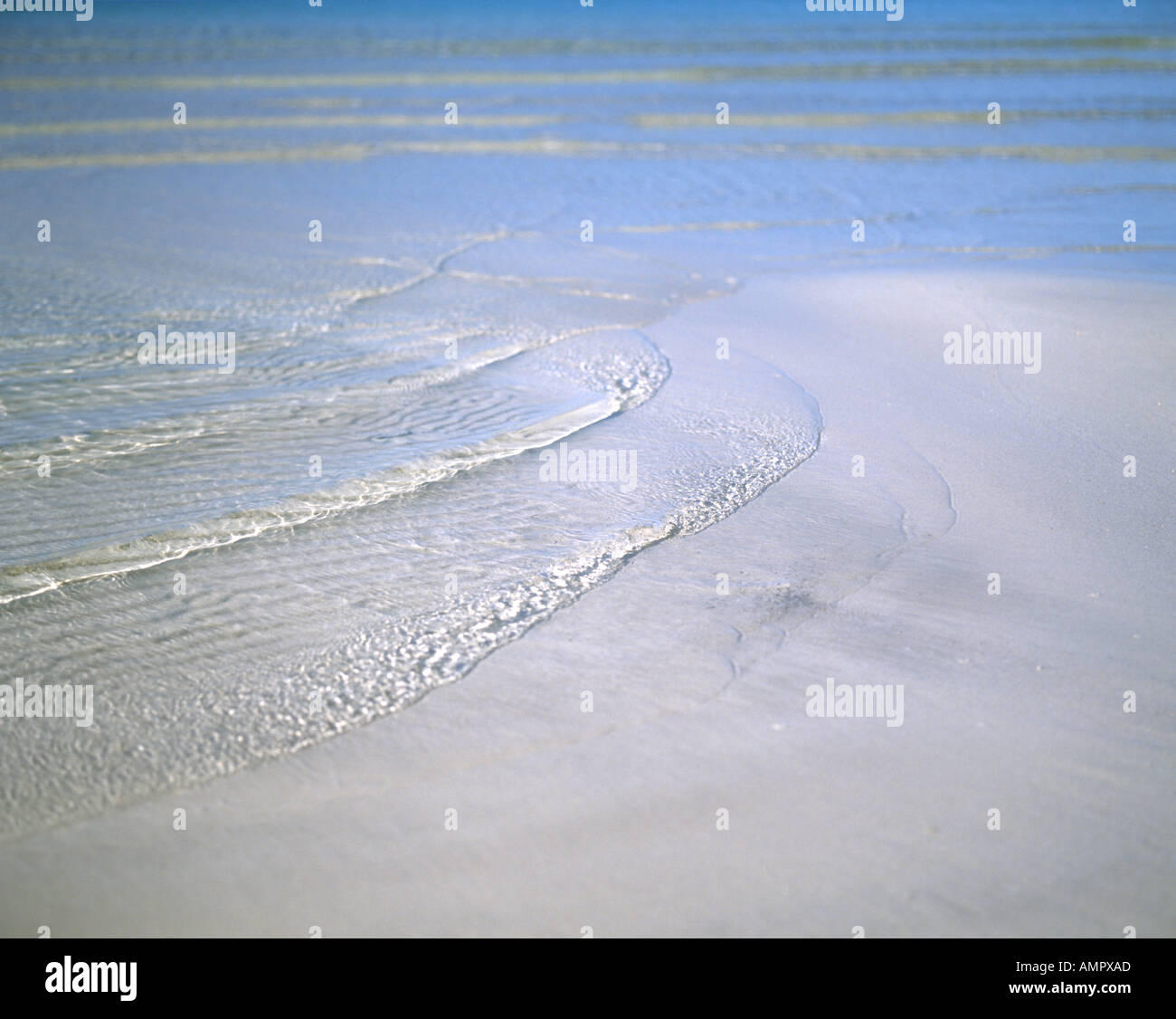 Soft waves at the sand beach - Stock Image