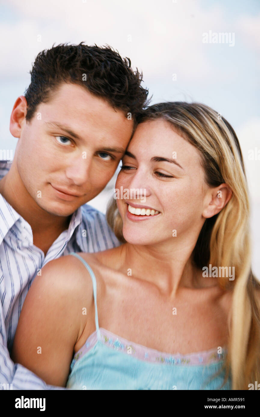 Couple hugging on the beach - Stock Image