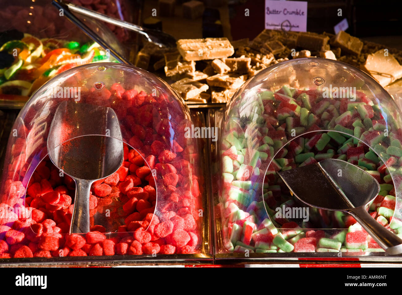 'Serve yourself' sweets on display on a market stall in Kingston upon Thames, Surrey, England. - Stock Image