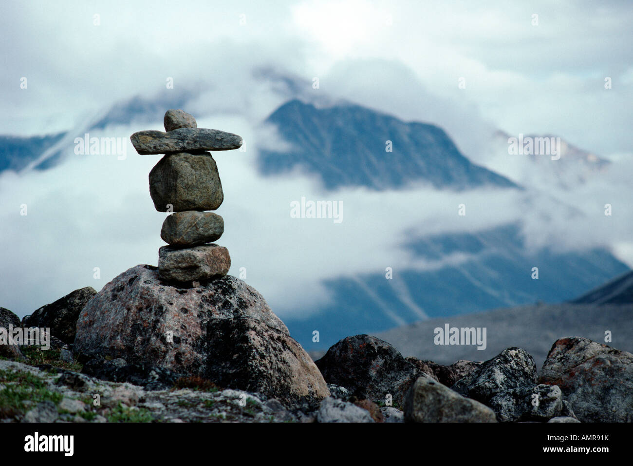 Rock Cairn Trail Marker Built By Inuit People Auyuittuq National Park Nunavut Canada, - Stock Image