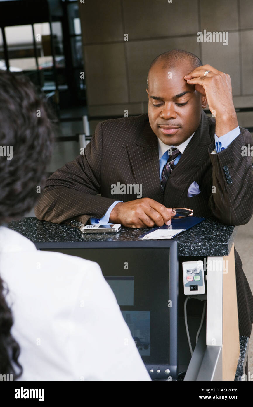 African businessman checking in at airport - Stock Image
