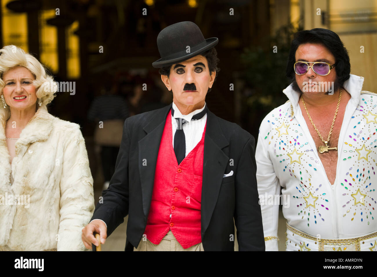 Celebrity Impersonators Charlie Chaplin Marilyn Monroe and Elvis on Hollywood Boulevard - Stock Image
