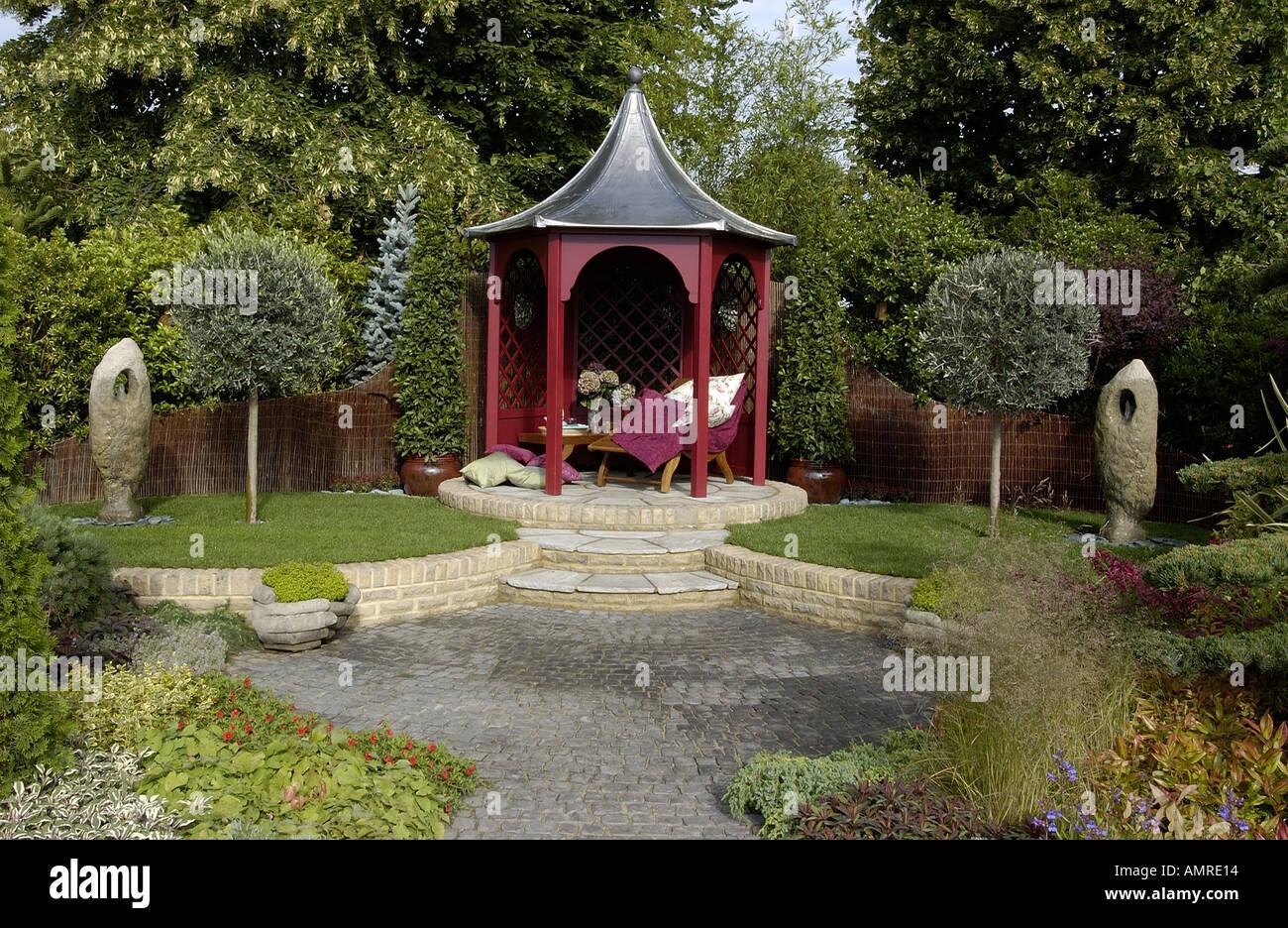 Summerhouse on a raised paved area - Stock Image