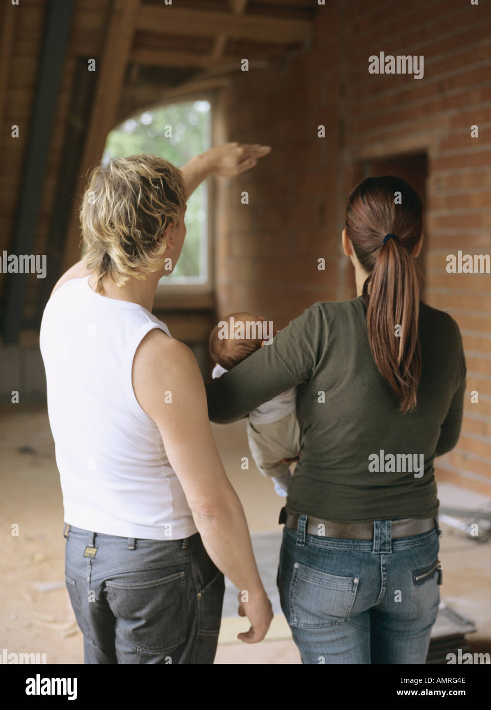 Young family visiting their future home - Stock Image