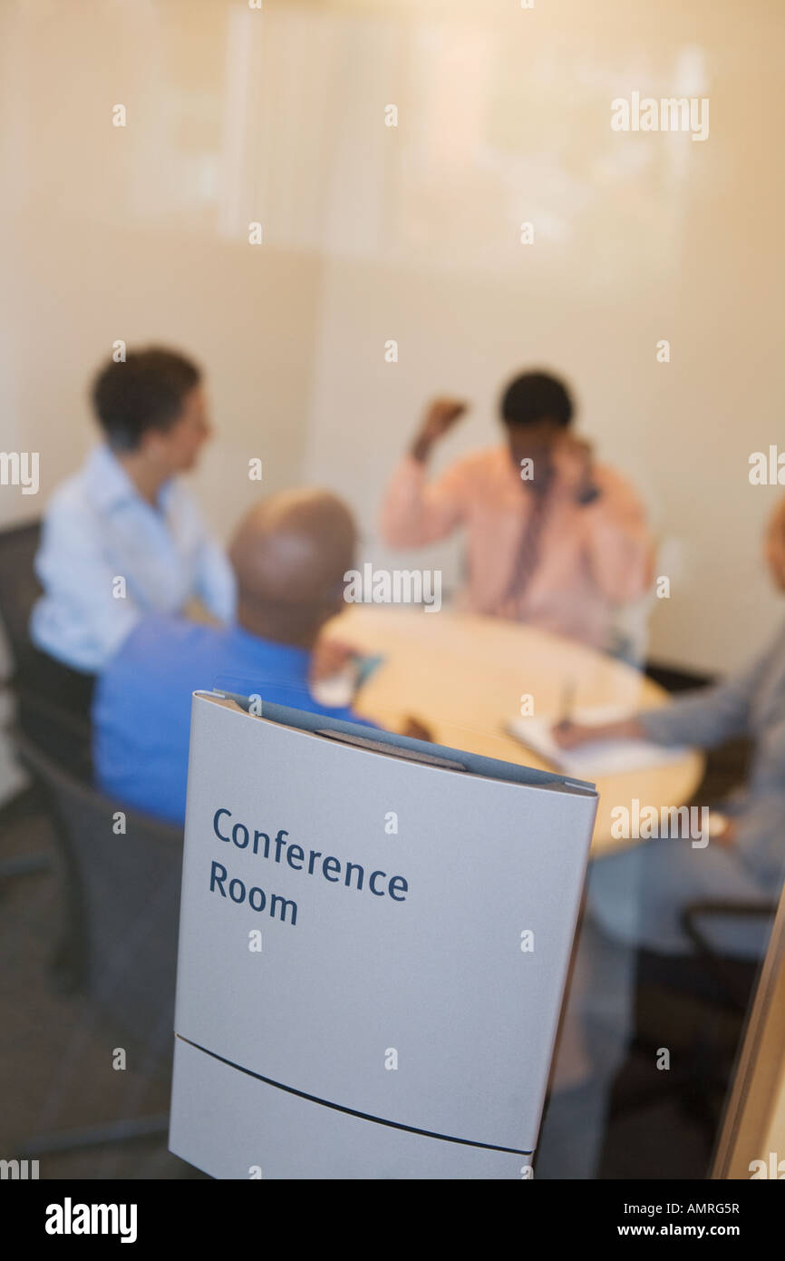 Businesspeople at meeting in conference room - Stock Image