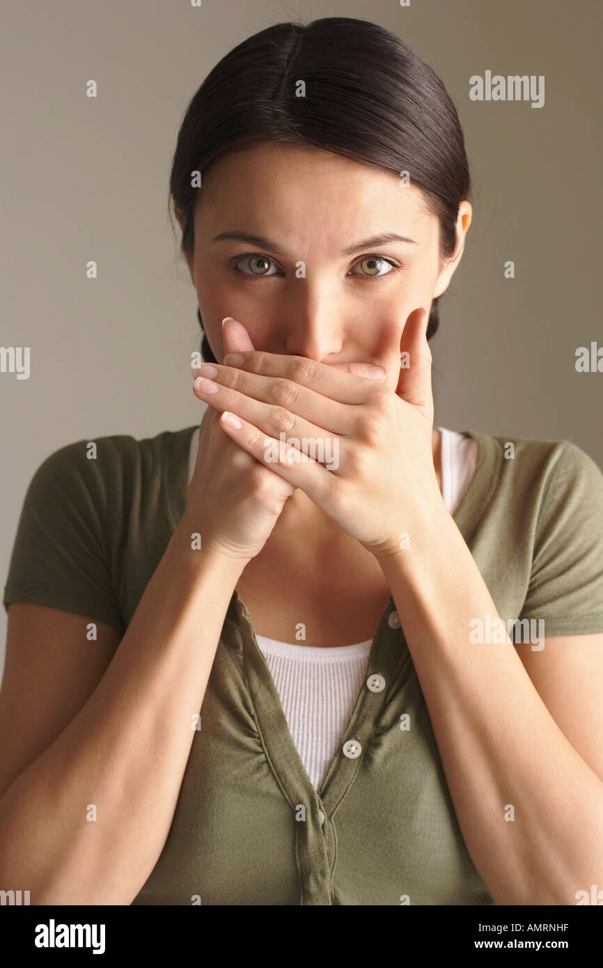 Woman Covering Mouth with Hands Stock Photo