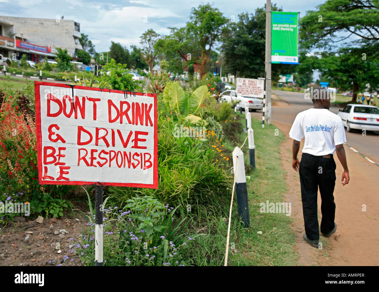 Hand-written sign Don't drink & drive. Be responsible. It set along the road in Kitwe city, Copperbelt, - Stock Image