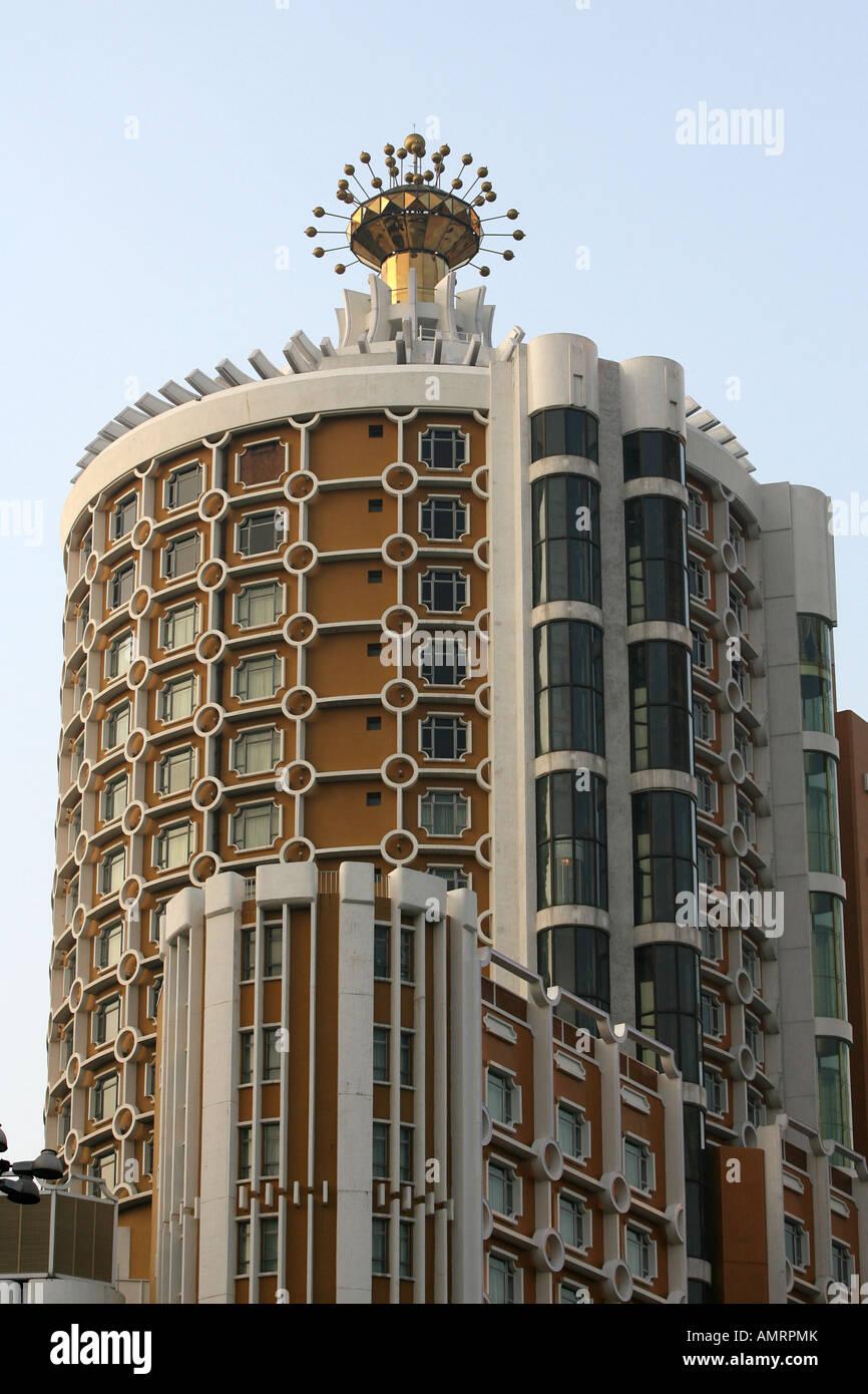 The old Lisboa hotel in Macau China - Stock Image