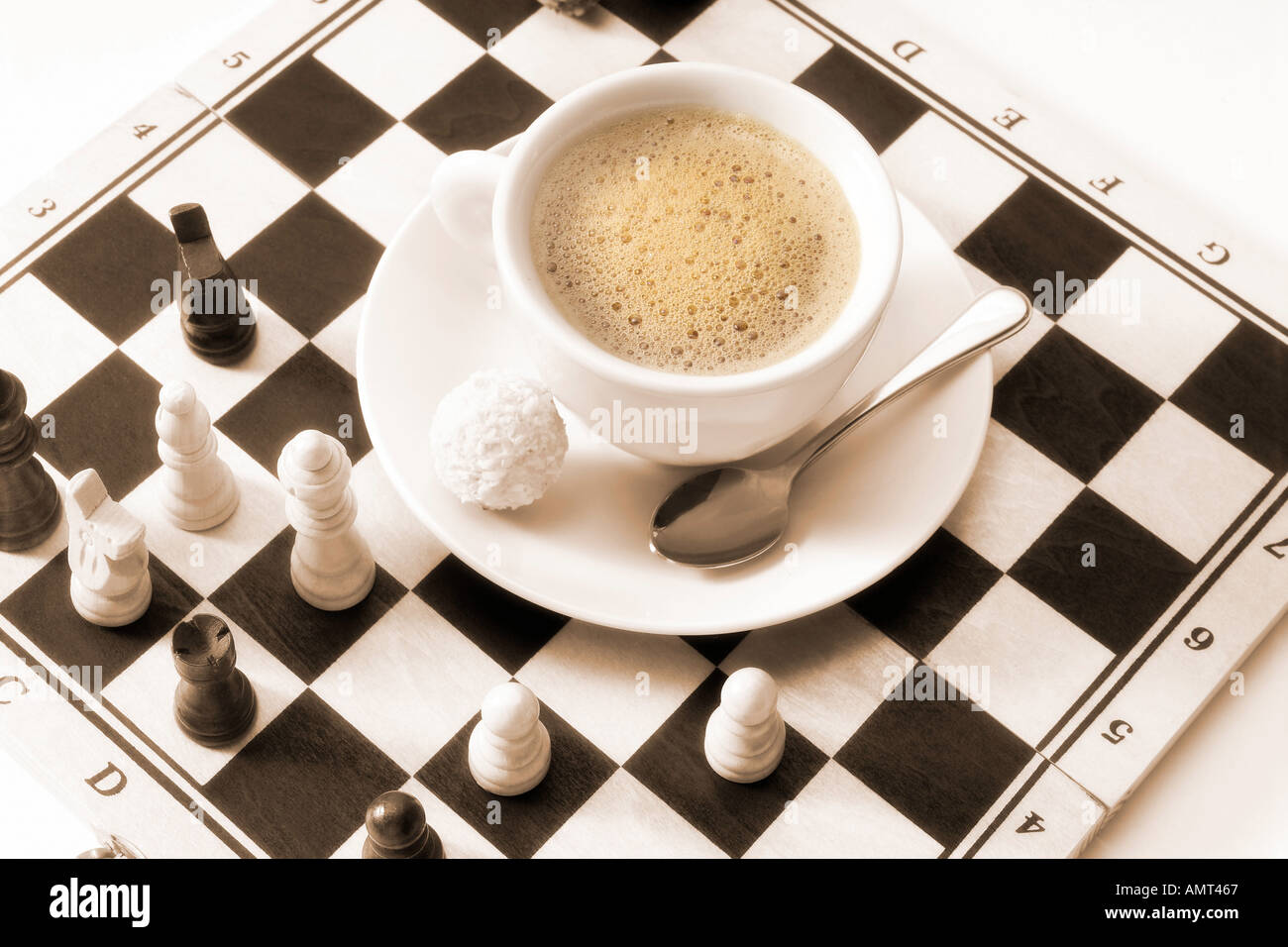 Cup of coffee on chess board - Stock Image
