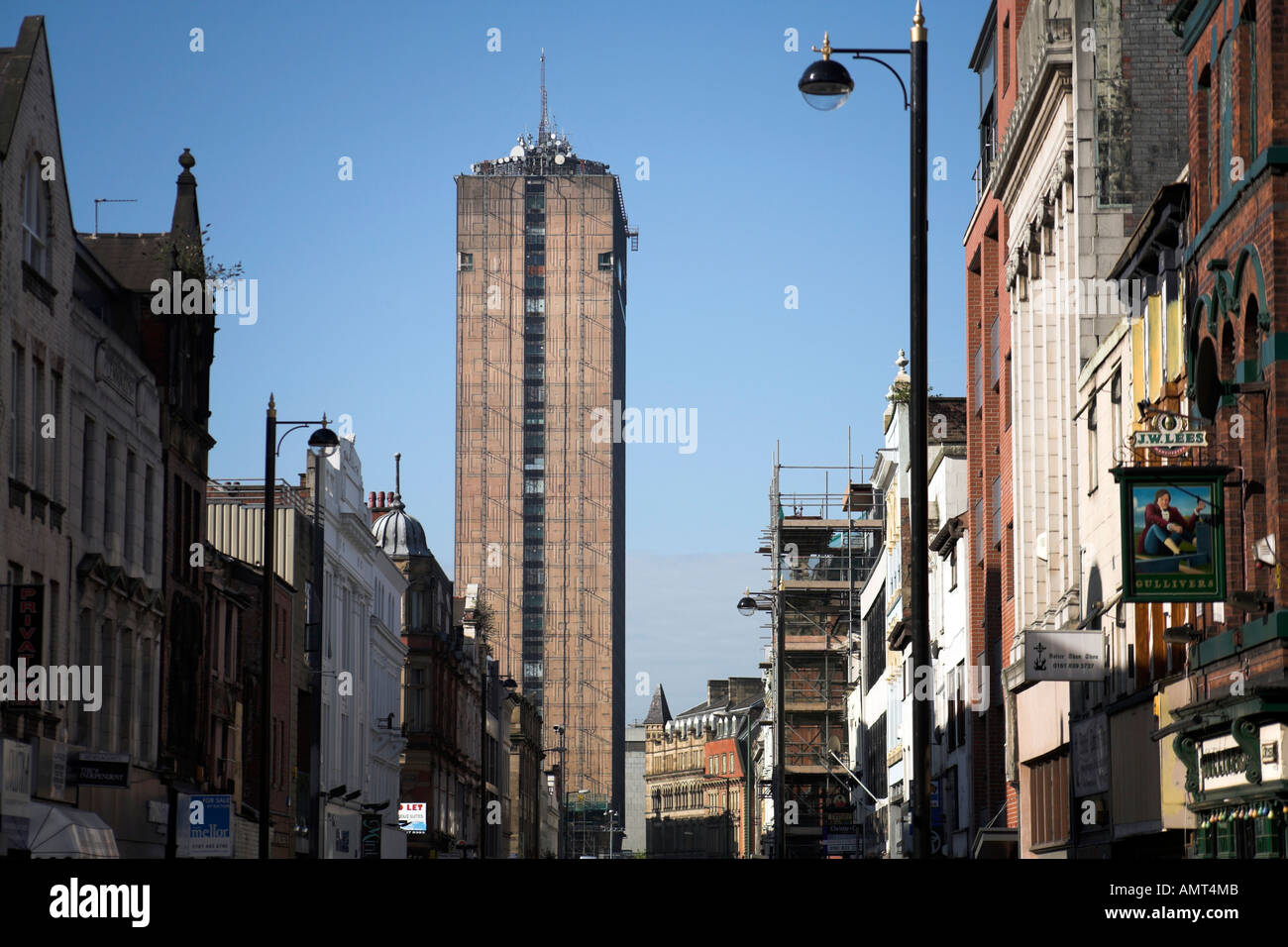 View to the south down Oldham Street one of Manchester s main streets looking towards the tower at Piccadilly Plaza UK 2006 - Stock Image