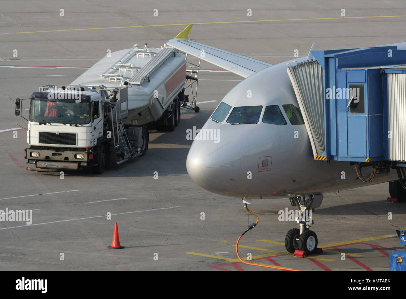 Jet plane refuelling on the ground at airport with fuel truck. Aviation and  air transport