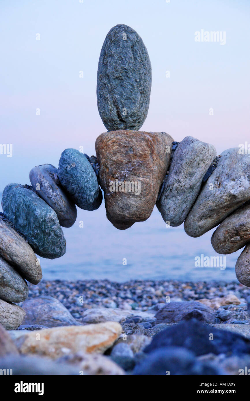 photo of stone in balance at the beach - Stock Image