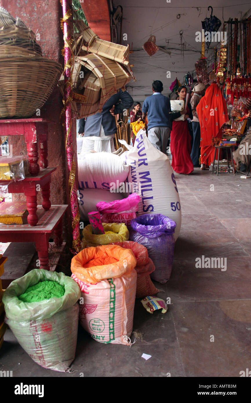 sacks of colour powder and baskets outside a shop in Jaipur, India - Stock Image