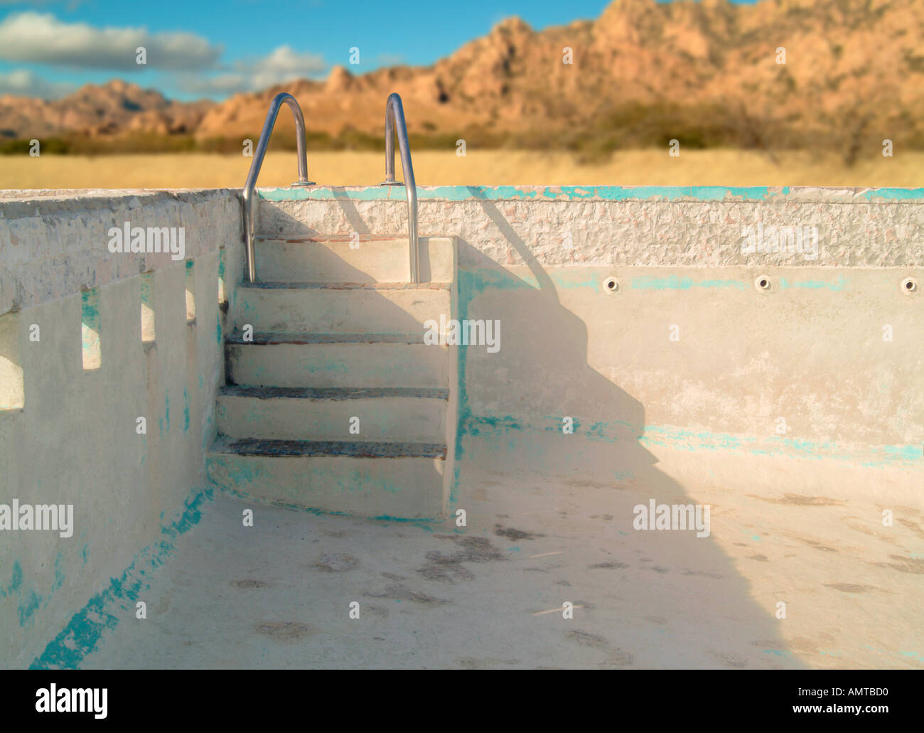 an empty concrete swimming pool with steps leading down into the ...