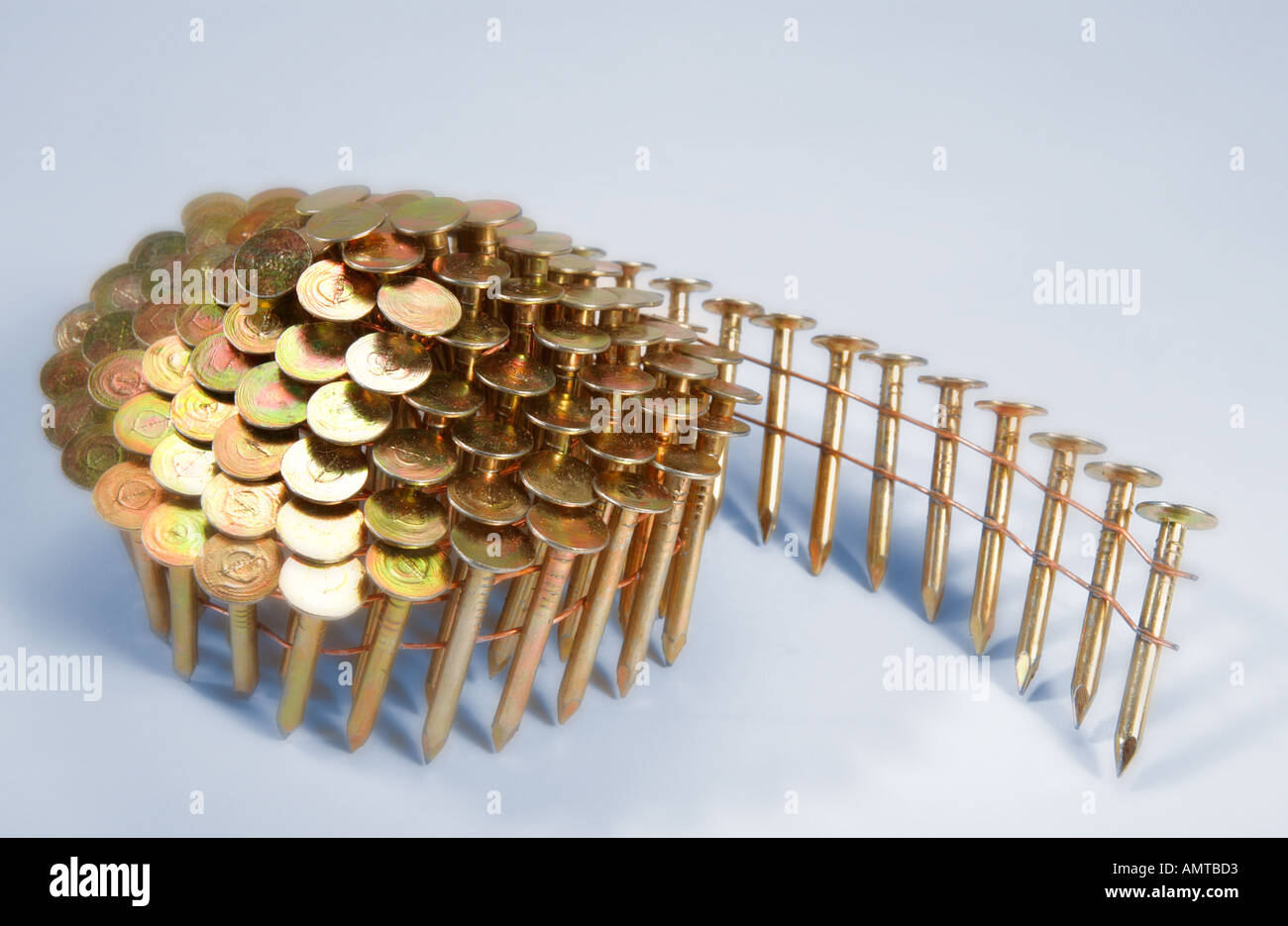 A roll of nails made for a builder's nail gun - Stock Image