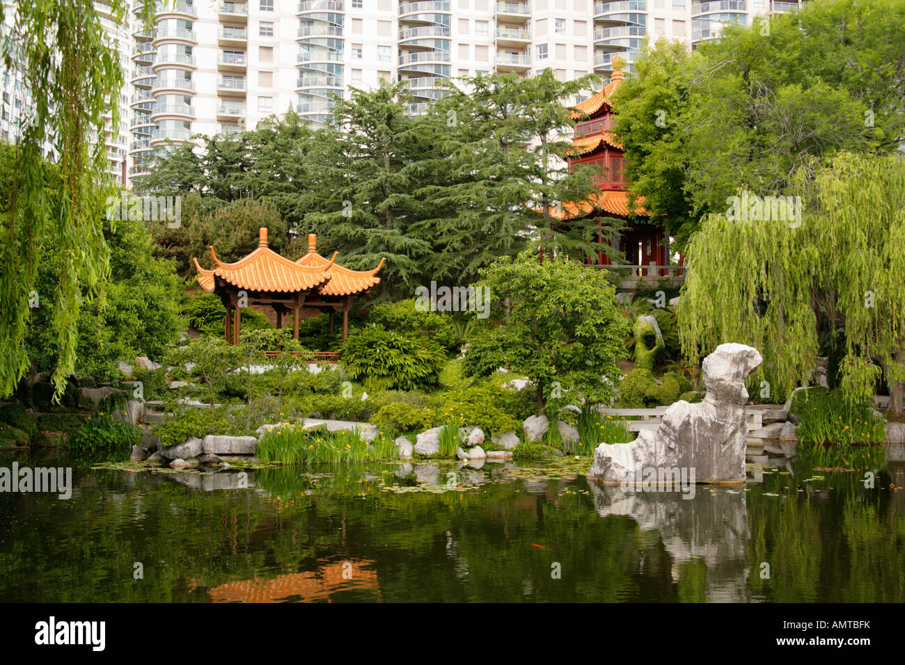 Lake With Rock Sculptures Pavilionsand Modern Highrise BuildingsChinese Garden Of Friendship