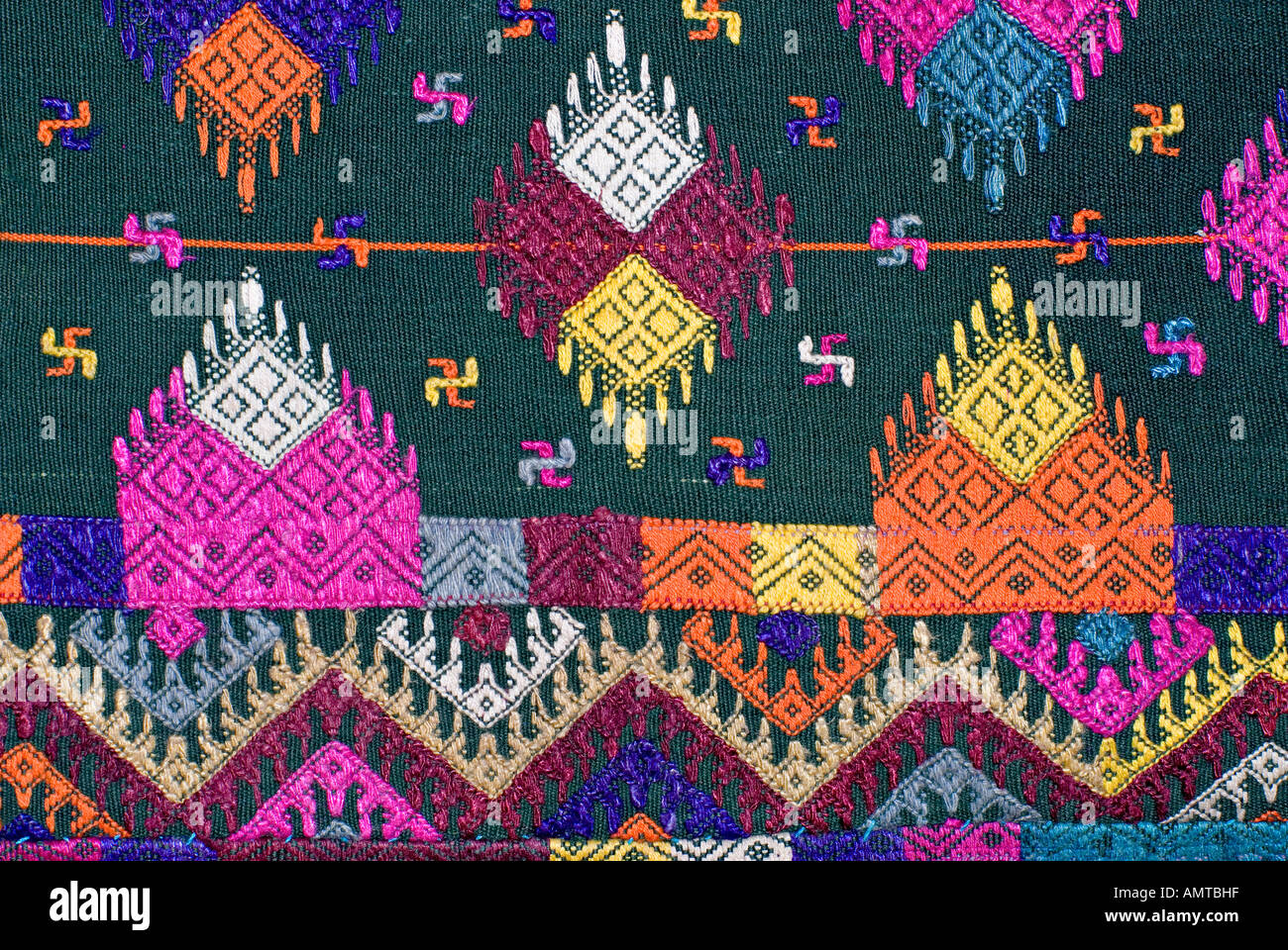 Detail of Bhutanese brocaded fabric with sumptuous supplementary weft brocading Woven on a hip strap loom Bhutan Stock Photo
