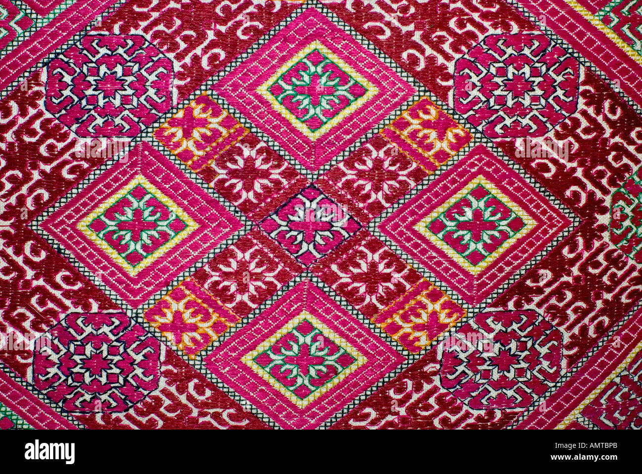 Ornately decorated Hazara matrimonial pillow covers Silk embroidery Katawaz Cushion Cover Acquired in Swat Valley Pakistan - Stock Image