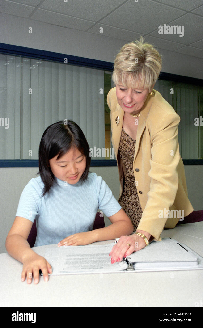 Students work in high school business careers class on the skills of job interviews and filling out job applications - Stock Image