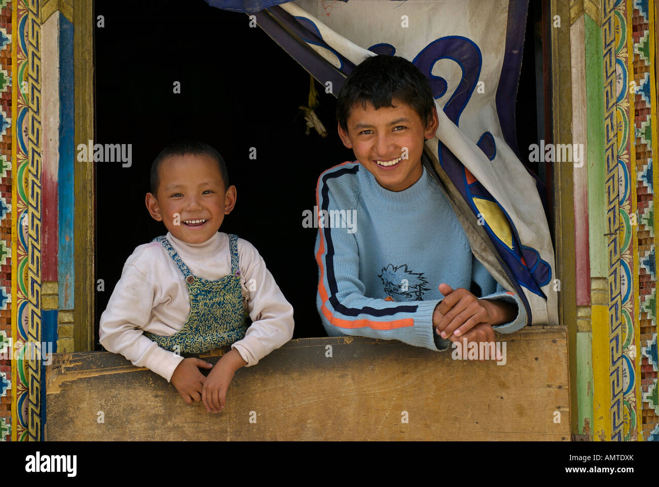 Tibetan brothers at the doorway to their home Gyantse Tibet - Stock Image