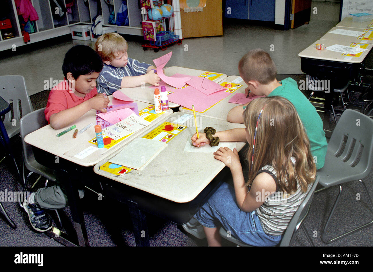 DM 1 st grade concept SPECIALIZATION 4 kids each do a different part of the whole product - Stock Image