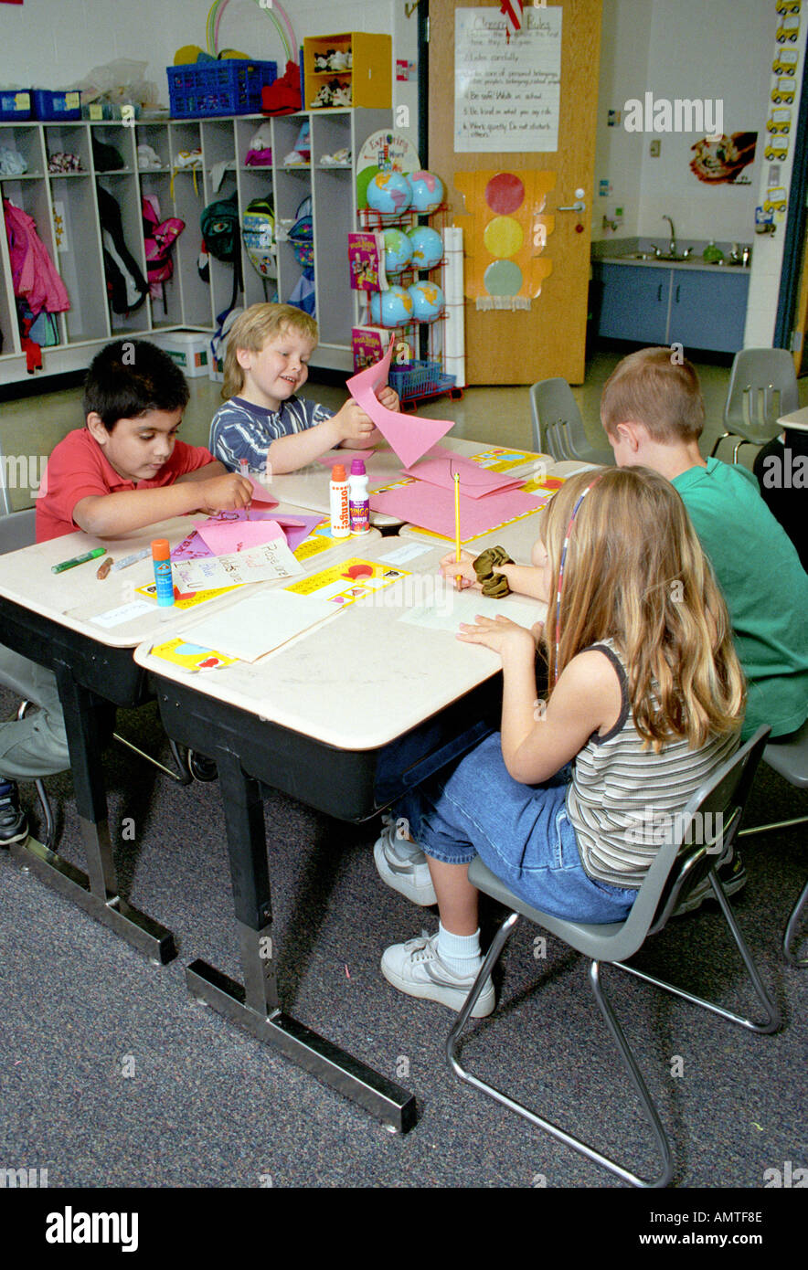 1 st grade concept SPECIALIZATION 4 kids each do a different part of the whole product - Stock Image