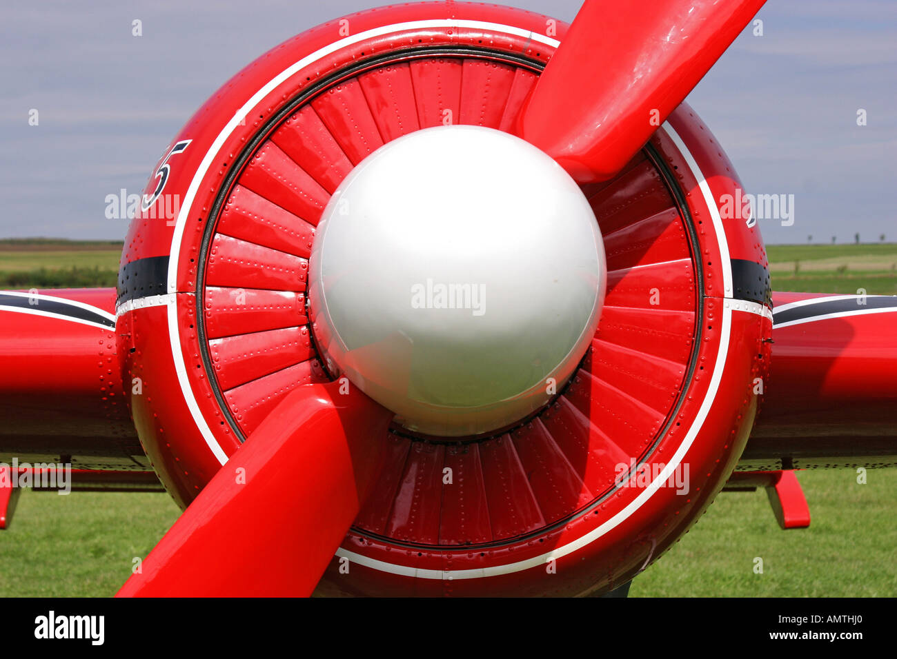 Front sight o a red Yak 55, legendary russian aerobatic aerplane, with propeller in diagonal Stock Photo