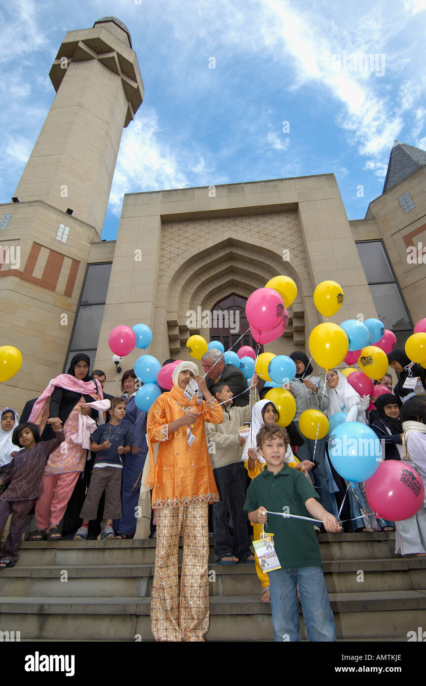 Children with coloured balloons at Edinburgh Central Mosque Stock Photo