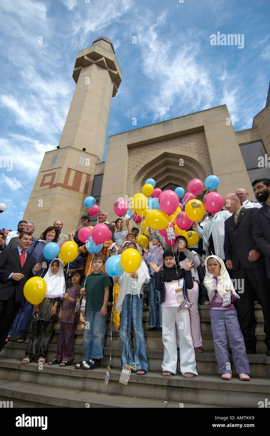 People and children with coloured balloons at Edinburgh Central Mosque Stock Photo