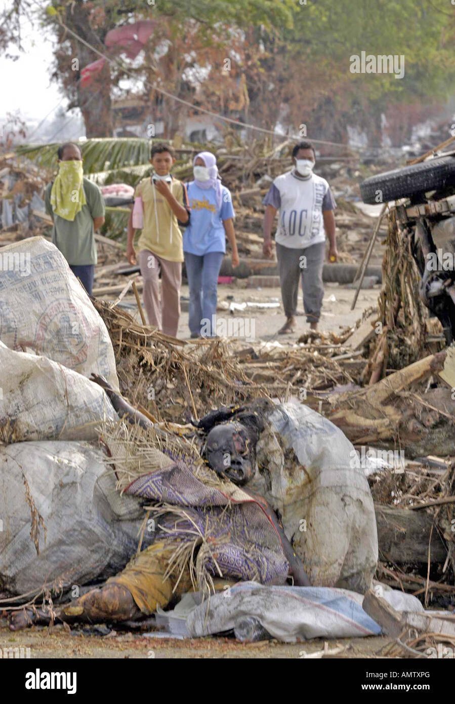 Relatives of missing family members walk towards a victim of the Dec 26th Tsunami in Banda Aceh Indonesia Stock Photo