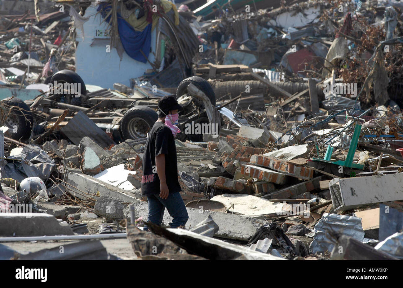 A man walks through the rubble in Banda Aceh Indonesia Stock Photo