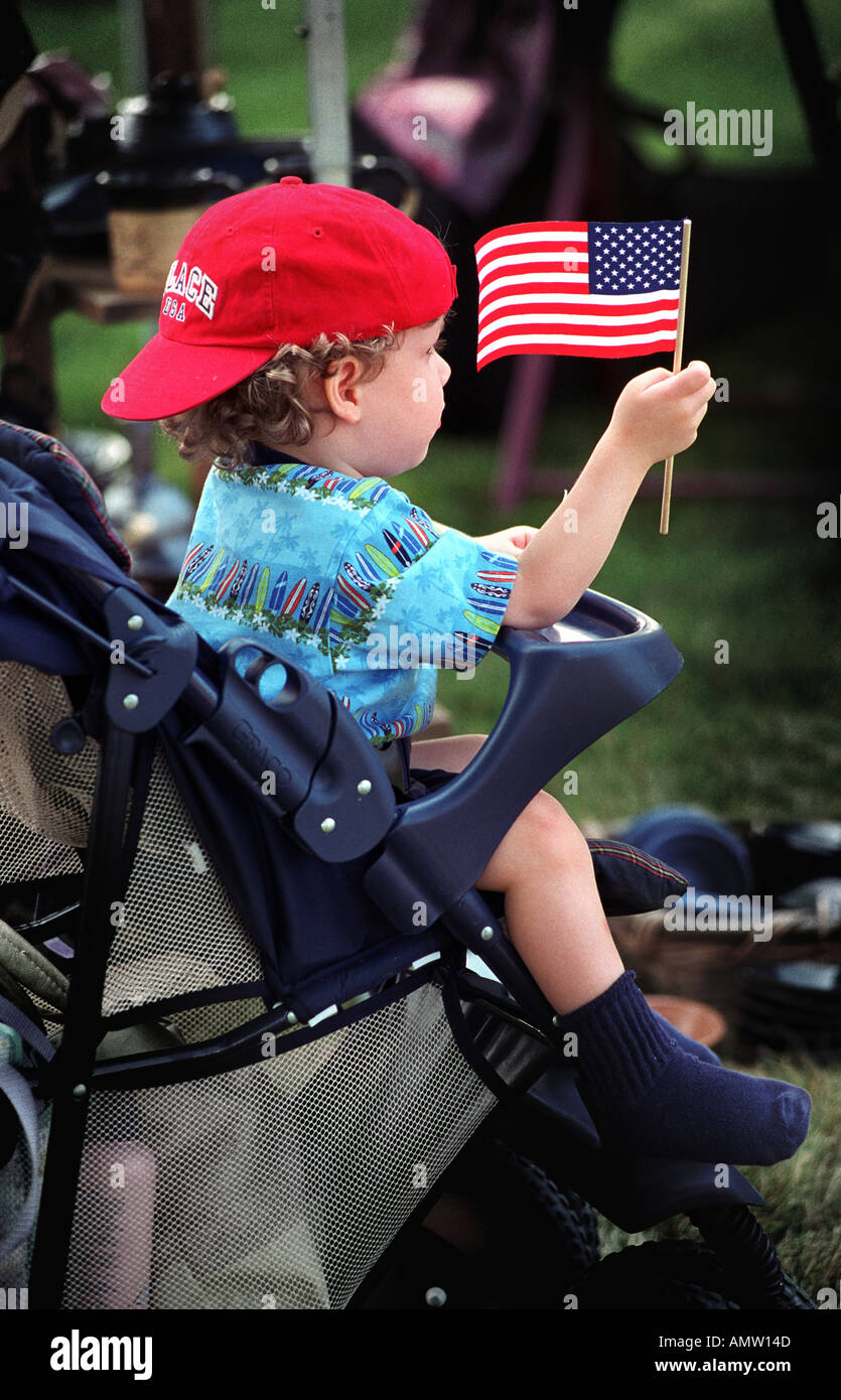 14 month boy sits in stroller with flag and hat on backwards Stock ... 25a8e513229