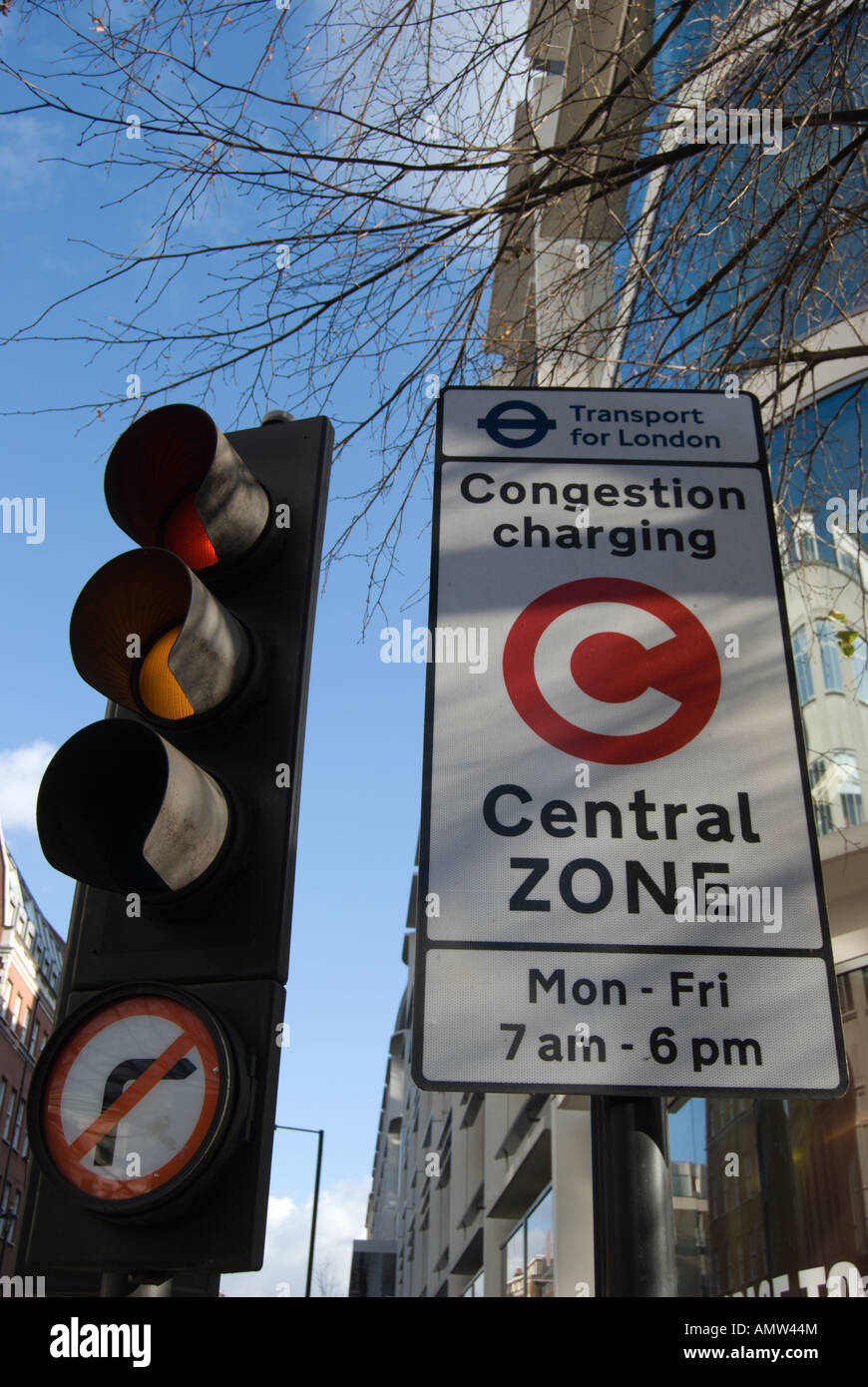 London central zone congestion charging sign and set of british traffic lights with no right turn sign - Stock Image
