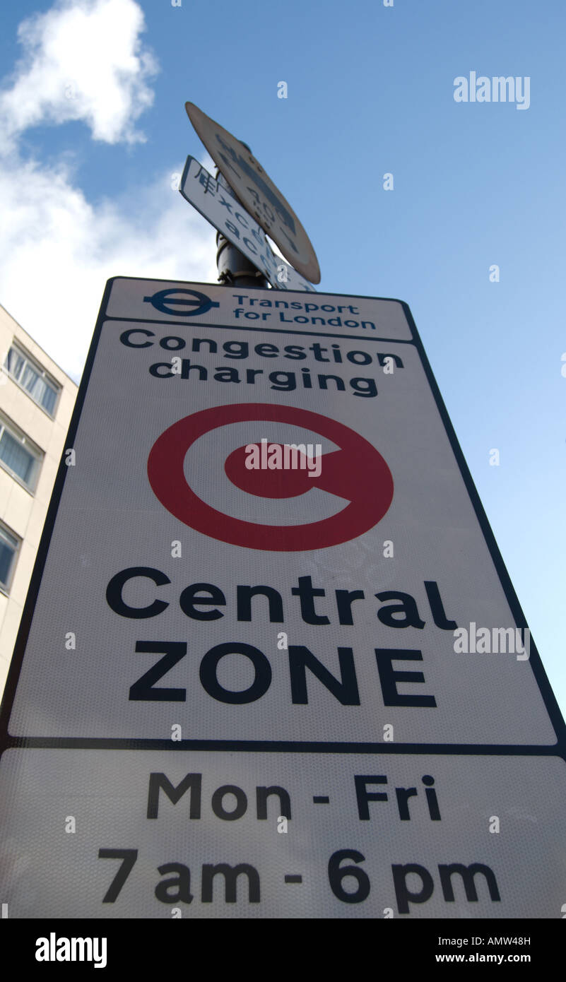 road sign indicating London's central zone congestion charge area, and days and hours of operation - Stock Image