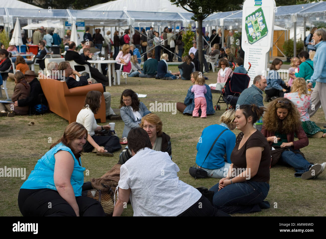 People sitting on the grass or on sofa at Edinburgh Book Festival 2006 - Stock Image