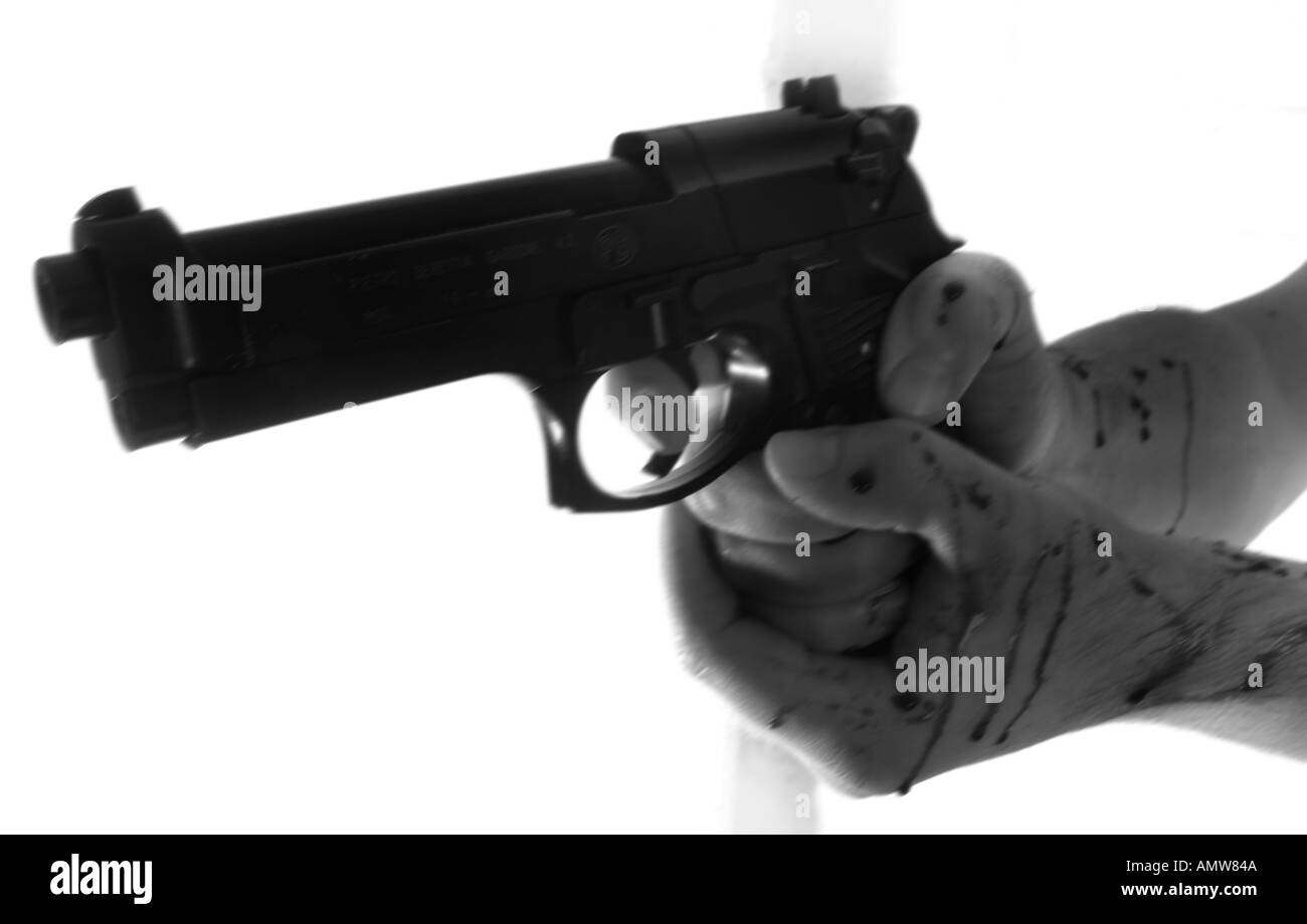 a monochrome of a pair of bloody hands firing a beretta gun - Stock Image